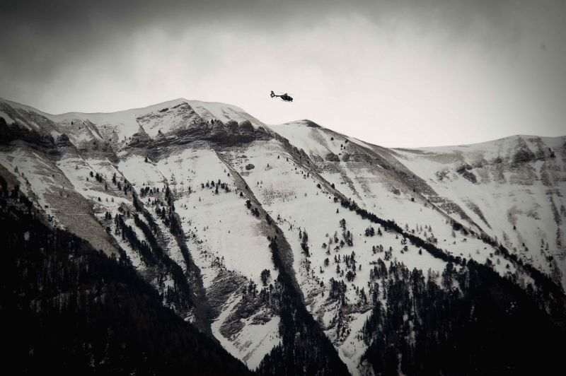 A rescue helicopter flies to the crash site of Germanwings Airbus A320 plane in the Alps in southern France, March 25, 2015. French gendarmes late Tuesday found one ...