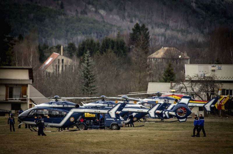 French gendarmes walk in the rescue base camp in the Alps in southern France, March 25, 2015. French gendarmes late Tuesday found one of the two black boxes of the ...