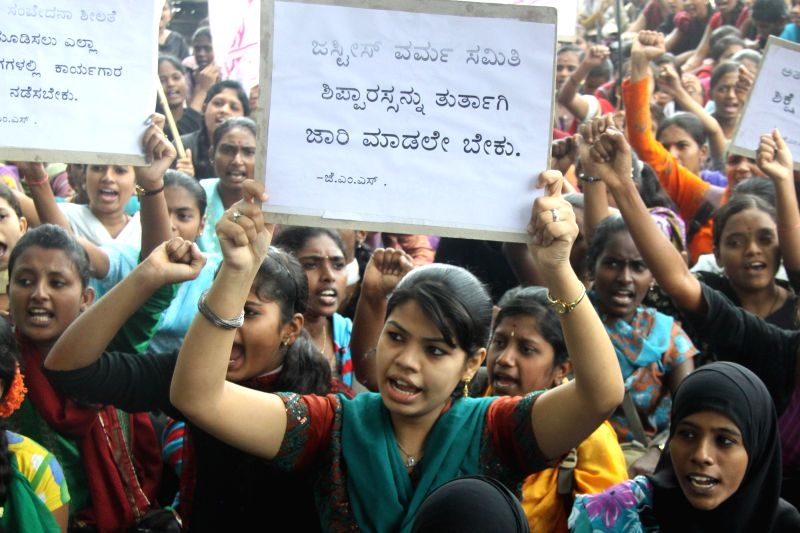 SFI activists stage a demonstrate to press for security for women at Freedom Park in Bangalore on July 19, 2014.