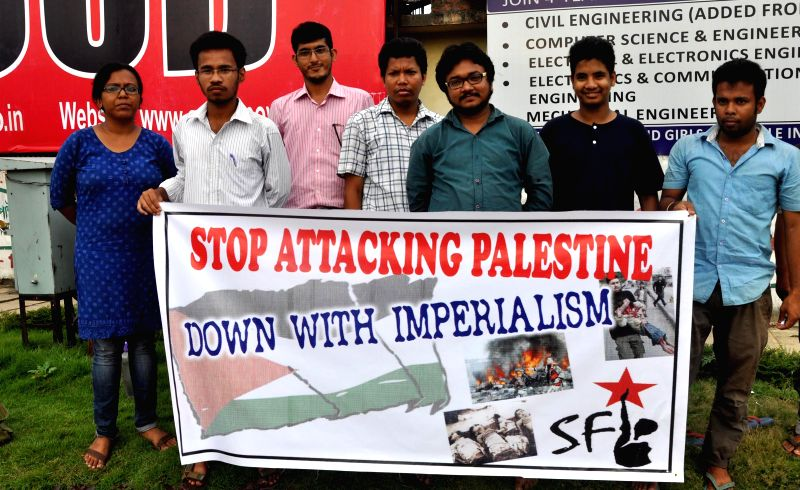 SFI activists stage a demonstration  against Israeli attacks on Gaza in Guwahati on July 18, 2014.