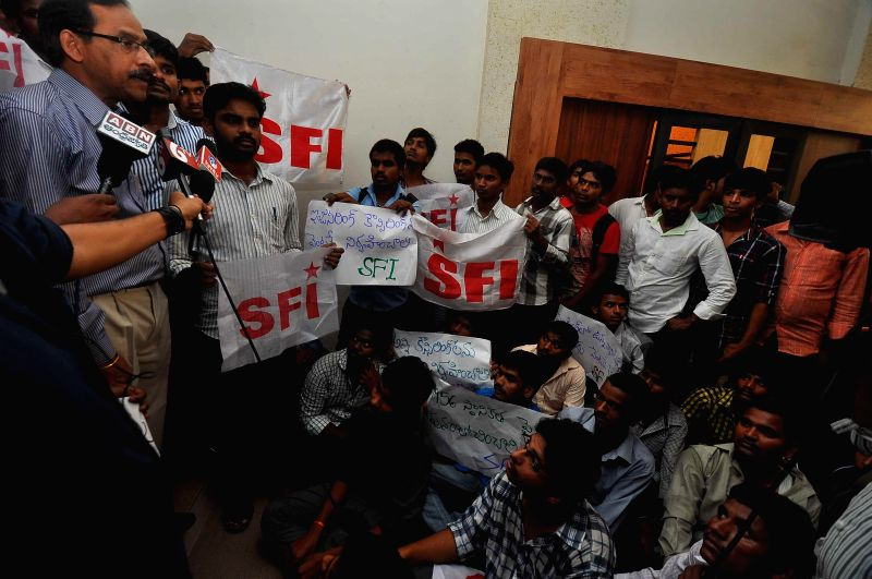 SFI activists stage a demonstration in Hyderabad on August 1, 2014.