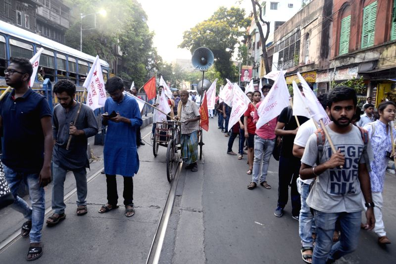 SFI and DYFI activists participate in a march organised to protest against police action on a student rally in Kolkata, on April 13, 2018.