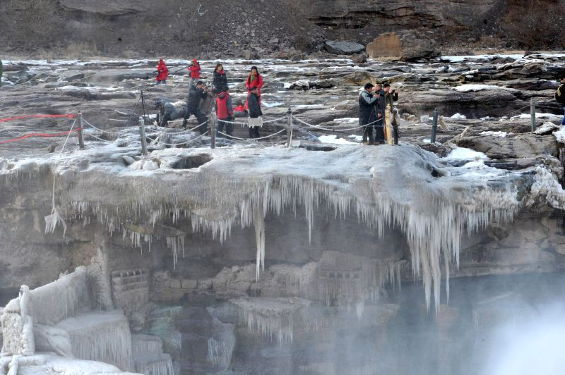Shaanxi(China):  Photo taken on Dec. 11, 2014 shows the icicles at the Hukou Waterfall on the Yellow River in northwest China's Shaanxi Province.
