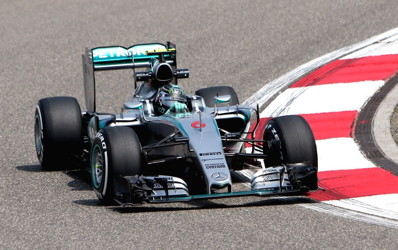 Mercedes AMG Petronas F1 Team's German driver Nico Rosberg drives his car during the first practice session of the Formula One Chinese Grand Prix in Shanghai, ...