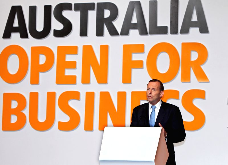 """Australian Prime Minister Tony Abbott speaks at a luncheon in Shanghai, east China, April 11, 2014. """"We are confident that we know the position of the black ."""
