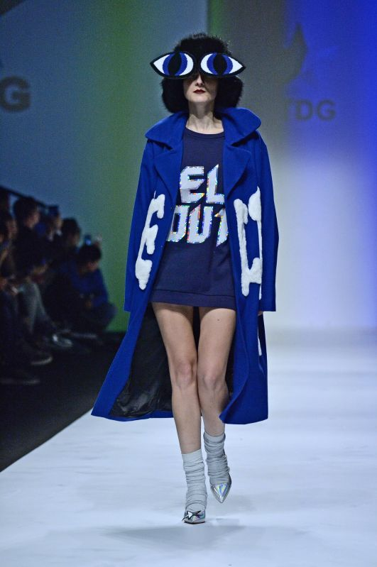 A model presents a creation of HTDG and SOLO CELEB. during the 2015 Shanghai Fashion Week Autumn/Winter in east China's Shanghai, April 13, 2015. HTDG and SOLO ...