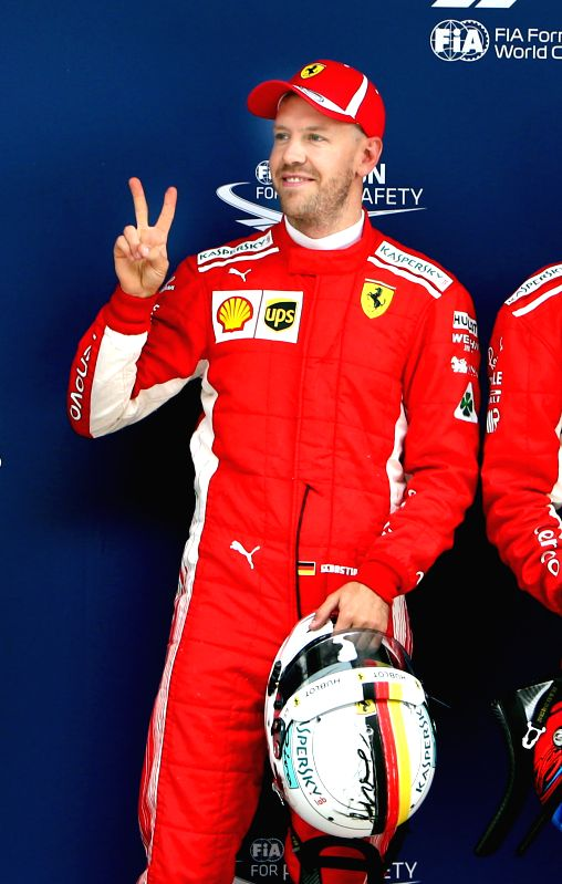 SHANGHAI, April 14, 2018 - First-placed Ferrari's driver Sebastian Vettel of Germany poses for photos after the qualifying of Formula 1 2018 Chinese Grand Prix in Shanghai, east China, April 14, 2018.