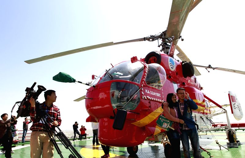 Visitors view a helicopter on board the Chinese research vessel and icebreaker Xuelong (Snow Dragon) in Shanghai, east China, April 15, 2014. The icebreaker ...