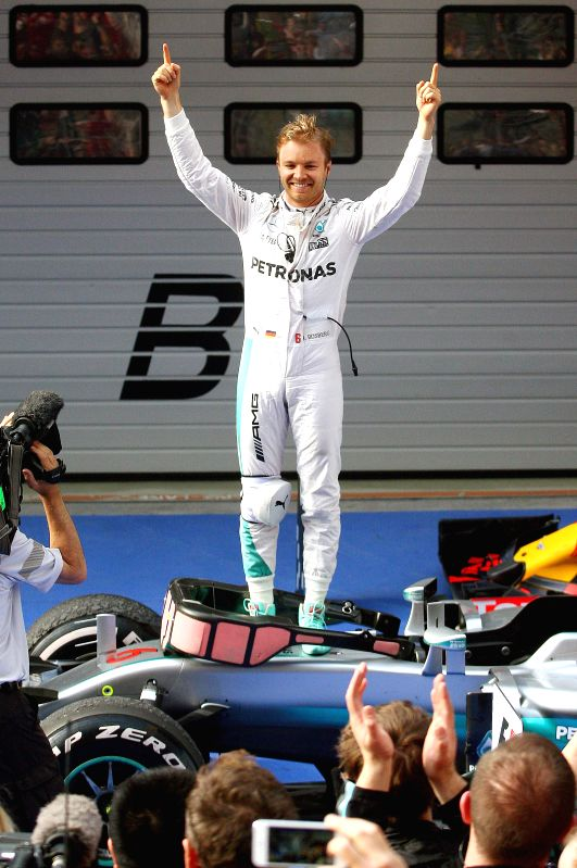 SHANGHAI, April 17, 2016 - Mercedes AMG Petronas F1 Team's German driver Nico Rosberg (top) celebrates after winning the Formula One Chinese Grand Prix in Shanghai on April 17, 2016.