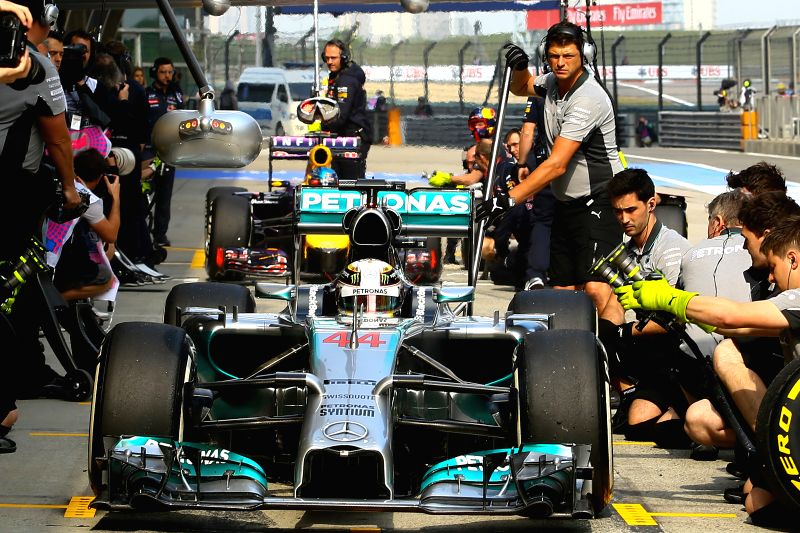 Mercedes driver Lewis Hamilton of Britain makes a pit stop during a practice session of the Formula One Chinese Grand Prix in Shanghai, China, on April 18, 2014.