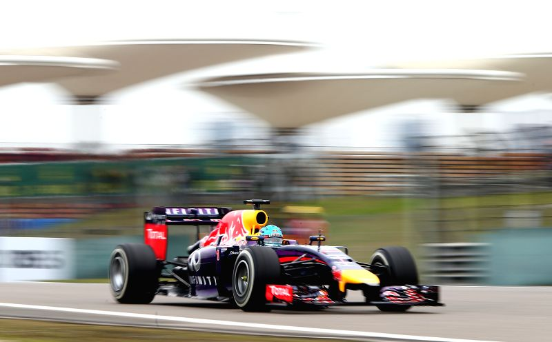 Red Bull Racing driver Sebastian Vettel of Germany competes during a practice session of the Formula One Chinese Grand Prix in Shanghai, China, on April 18, 2014.