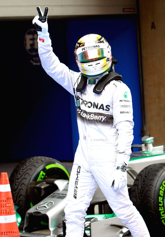 Mercedes AMG Petronas British driver Lewis Hamilton celebrates after the qualifying session at the Formula One Chinese Grand Prix in Shanghai on April 19, 2014. ..