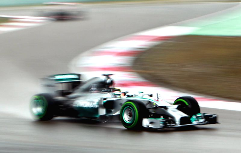 Mercedes AMG Petronas British driver Lewis Hamilton competes during the qualifying session at the Formula One Chinese Grand Prix in Shanghai on April 19, 2014. ...