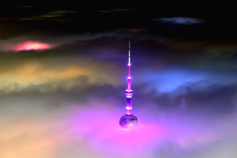 Photo taken from the 121st floor of the Shanghai Tower on April 1, 2015 shows the Oriental Pearl Radio and TV Tower amid heavy fog in Shanghai, east China. ...