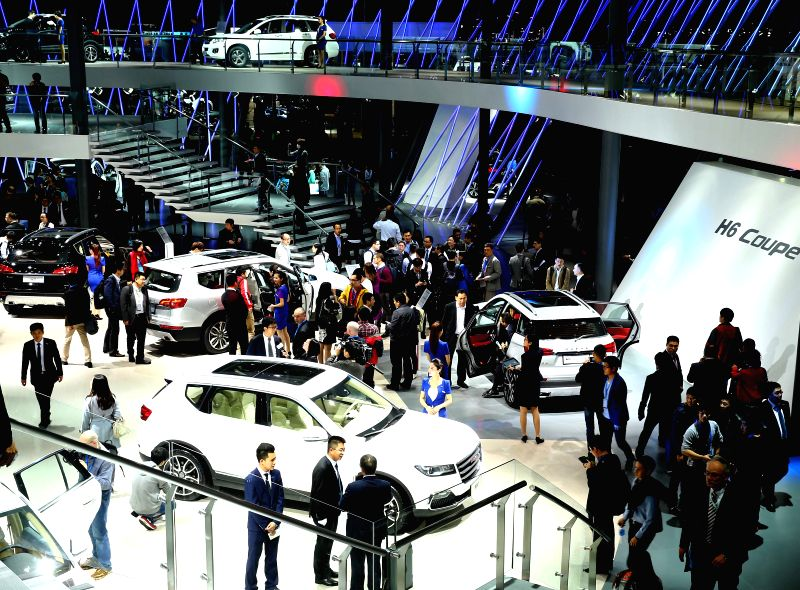 People visit the Auto Shanghai 2015 in east China's Shanghai, April 20, 2015. A total of 1,343 complete vehicles were on display, including 103 new energy ...
