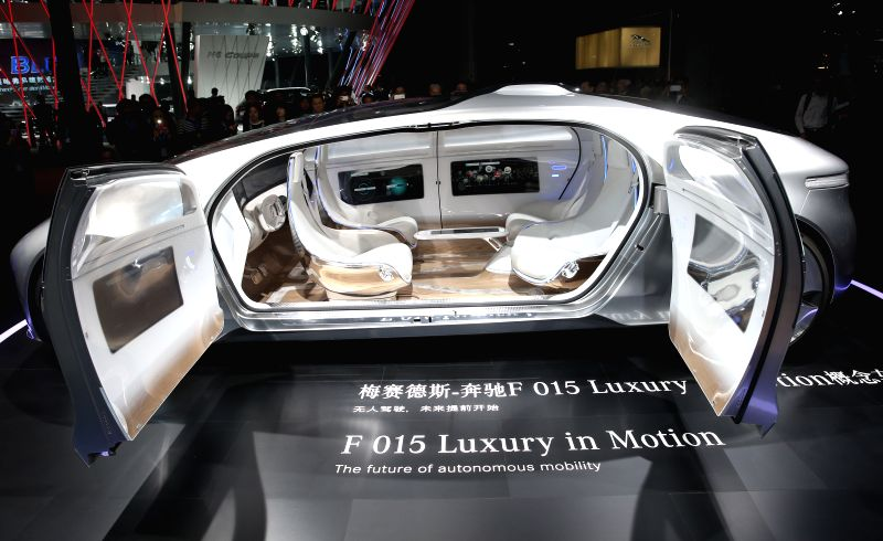 Visitors look at a Mercedes-AMG GT S displayed in the Auto Shanghai 2015, east China's Shanghai, April 20, 2015. A total of 1,343 complete vehicles were on ...