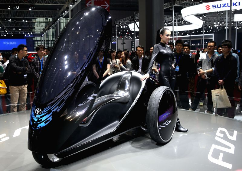 People watch a Toyota concept car FV2 at 2015 Shanghai International Automobile Industry Exhibition in Shanghai, China, April 22, 2015. A total of 1,343 complete ...