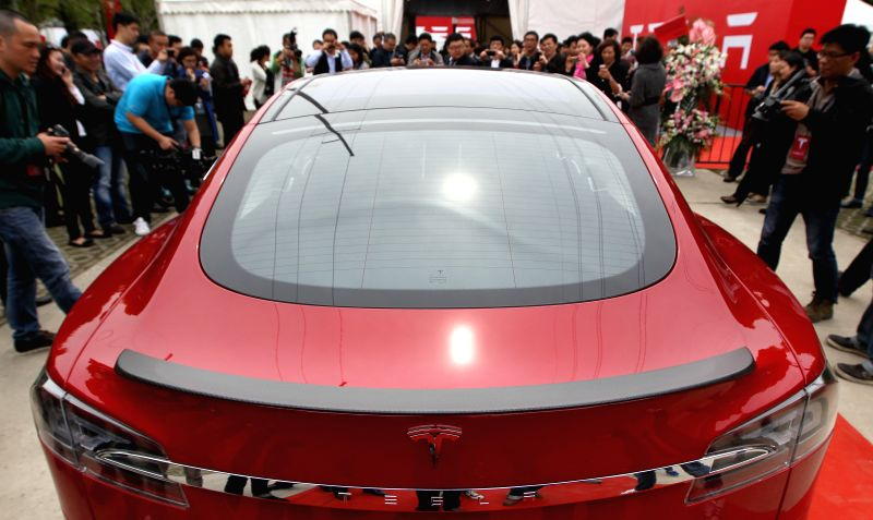 Photo taken on April 23, 2014 shows a Tesla vehicle in Shanghai, east China. The first supercharger charging station of Tesla in China opened on Wednesday and the