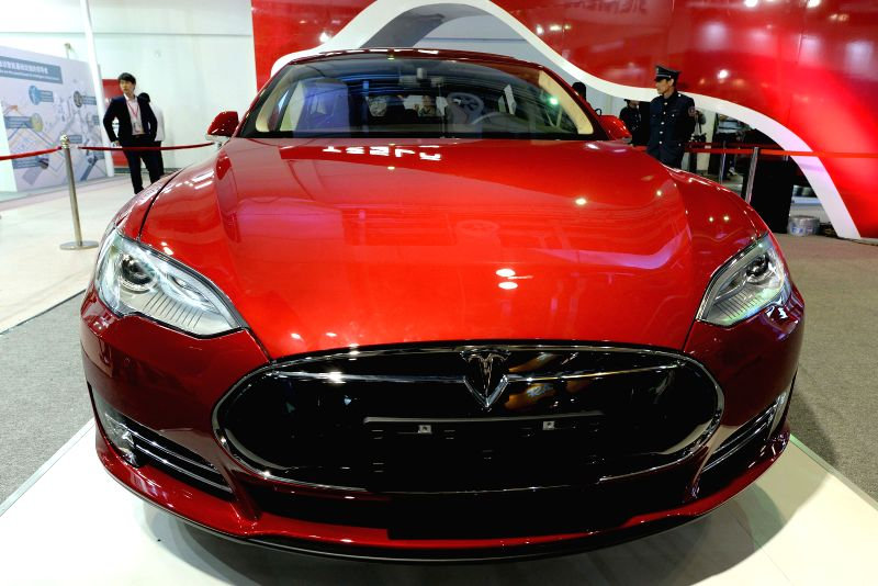 Photo taken on April 24, 2014 shows a Tesla vehicle presented on the 2nd China Shanghai International Technology Fair (CSITF) in east China's Shanghai. Tesla ...