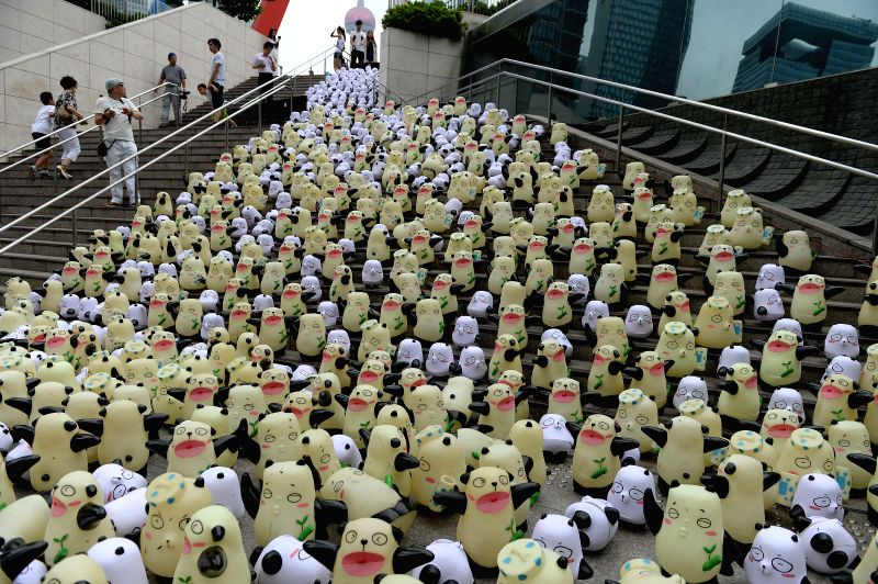 """Tourists watch """"Pan Da"""", which is designed to be an image of panda in Shanghai World Financial Center in Shanghai, east China, Aug. 8, 2014. 1000 ..."""