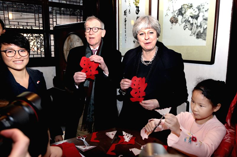 SHANGHAI, Feb. 2, 2018 - British Prime Minister Theresa May shows paper-cutting made by herself at Yuyuan Garden in Shanghai, east China, Feb. 2, 2018. - Theresa May