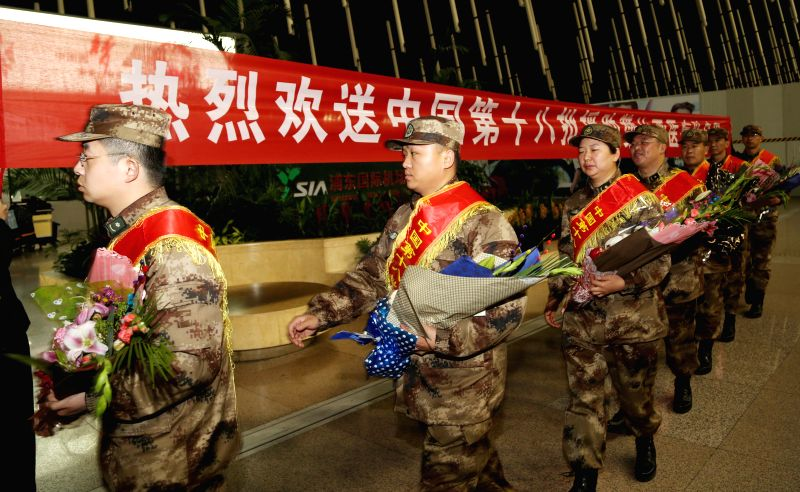 Members of a Chinese medical team attend a farewell ceremony before departing for Zambia at the Pudong International Airport in Shanghai, east China, Jan. 17, ...