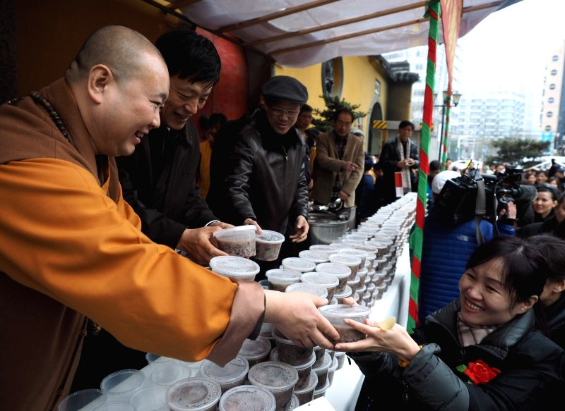 Laba congee is distributed to people at a buddhist temple in Shanghai, east China, Jan. 27, 2015. Laba, a traditional Chinese festival celebrated on the 8th day of ...