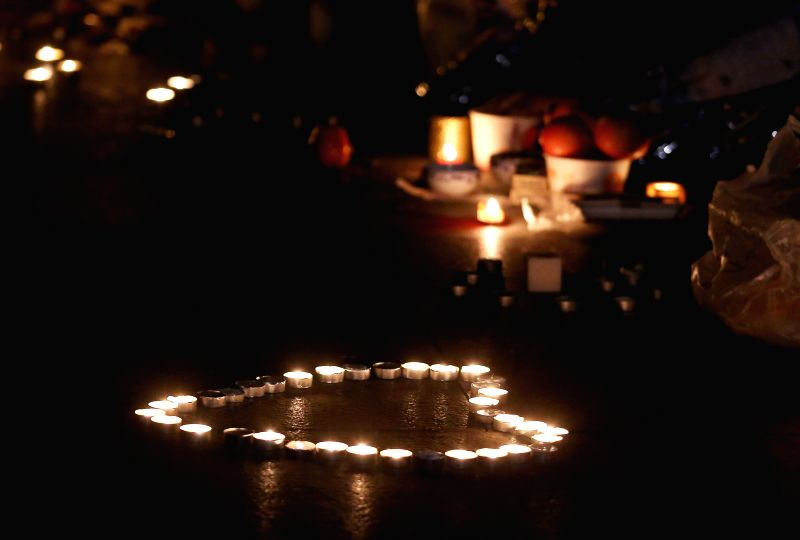 Candles are put in a heart-shaped layout by citizens to mourn for victims of a stampede in east China's Shanghai, on the early hours of Jan. 3, 2015. Many citizens .