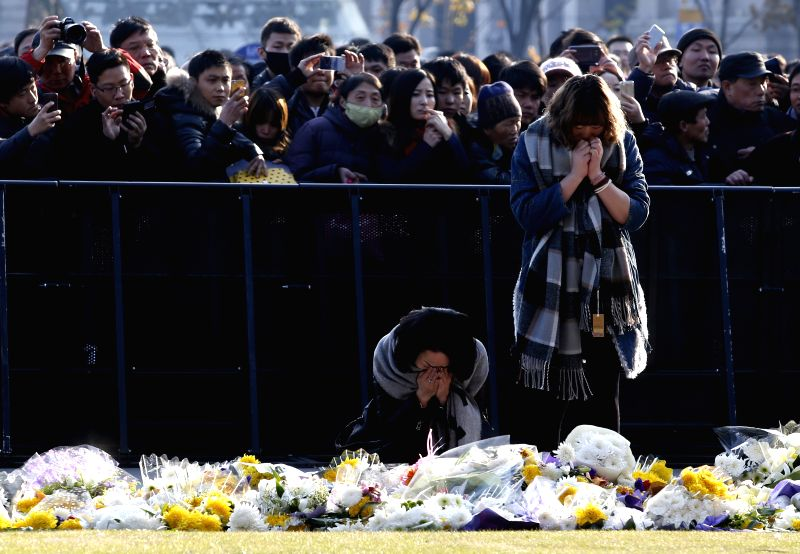 Citizens mourn for stampede victims in the Bund, east China's Shanghai, Jan. 3, 2015. Shanghai authorities have verified and unveiled all identities of the 36 ...