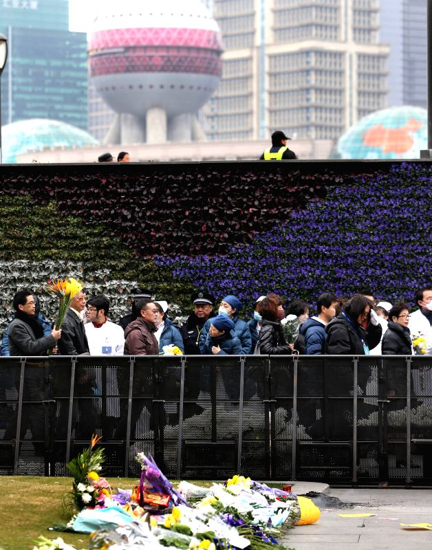 Flowers are presented to mourn for stampede victims at the Bund in Shanghai, east China, Jan. 6, 2015, seven days after the tragedy.