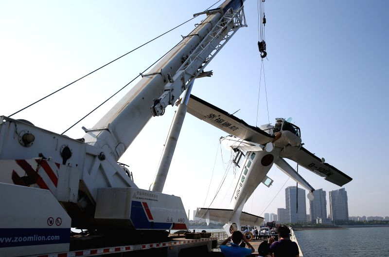 SHANGHAI, July 20, 2016 - Photo taken on July 20, 2016 shows the wreckage of an amphibian plane being retrieved from the water by a crane in Shanghai, east China. Five people were killed when an ...