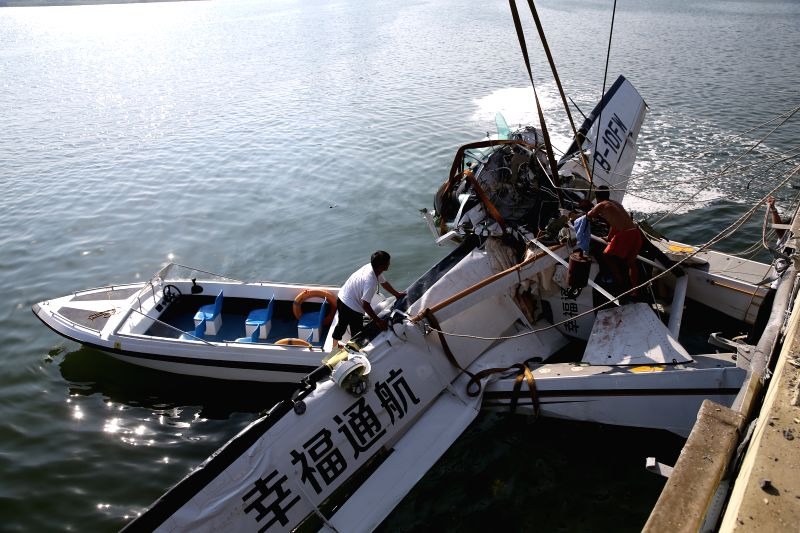 SHANGHAI, July 20, 2016 - Rescuers retrieve the wreckage of an amphibian plane from the water by a crane in Shanghai, east China, July 20, 2016. Five people were killed when an amphibian plane hit a ...