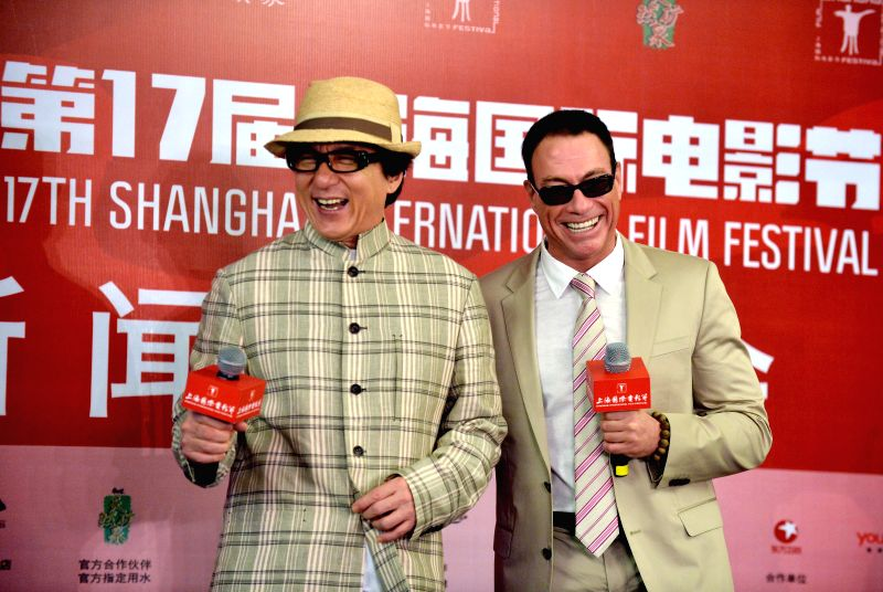 Actor Jackie Chan and international action star Jean-Claude Van Damme in Shanghai to attend the ``International action Jackie Chan Film Week`` the press conference