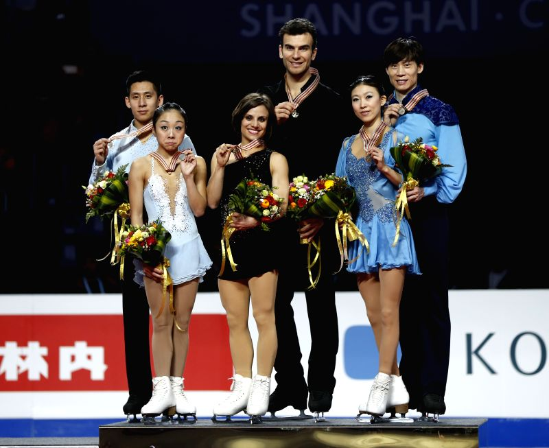 Gold medalists Meagan Duhamel and Eric Radford (C) of Canada, silver medalists China's Sui Wenjing/Han Cong (L) and bronze medalists China's Pang Qing/Tong Jian ...