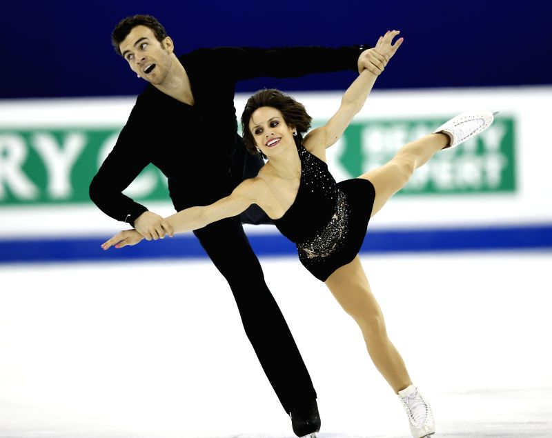 Meagan Duhamel (R) and Eric Radford of Canada compete during the Pairs Free Skating segment in ISU World Figure Skating Championships 2015 at Crown Indoor ...