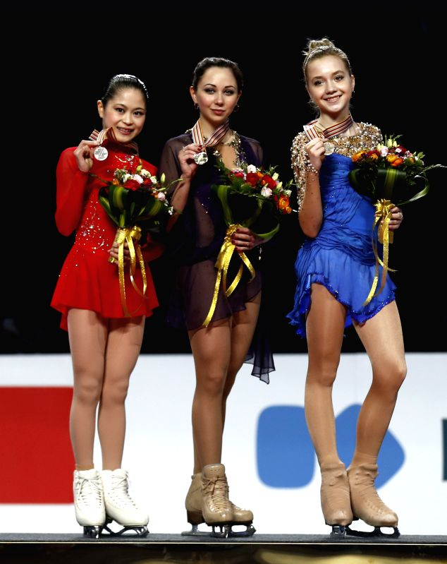 Gold medalist Elizaveta Tuktamysheva (C) of Russia, silver medalist Satoko Miyahara of Japan (L) and bronze medalist Elena Radionova of Russia pose during the ...