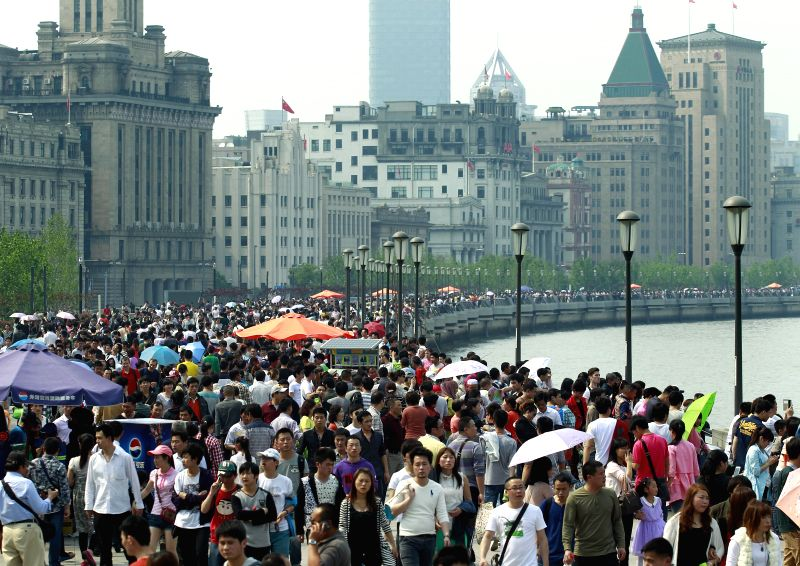 People visit the Bund in Shanghai, east China, May 1, 2014. Scenery spots of Shanghai attracted many tourists on Thursday, the first day of the three-day Labor Day ..