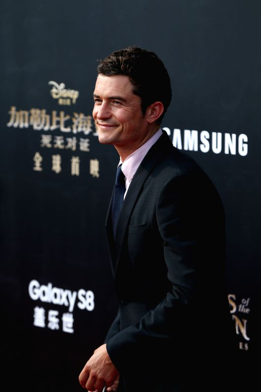 "SHANGHAI, May 11, 2017 - Actor Orlando Bloom attends the global premiere of Hollywood film ""Pirates of the Caribbean: Dead Men Tell No Tales"", in Shanghai, China, May 11, 2017. (Xinhua/Ding ... - Orlando Bloom"