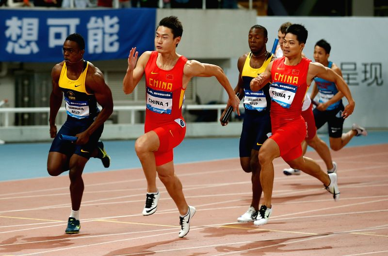 SHANGHAI, MAY 14, 2016 - Su Bingtian (R in red) and Zhang Peimeng (L in red) of China 1 team compete during 4X100 Relay Men Race at 2016 IAAF Diamond League in Shanghai, China on May 14, 2016. China ...