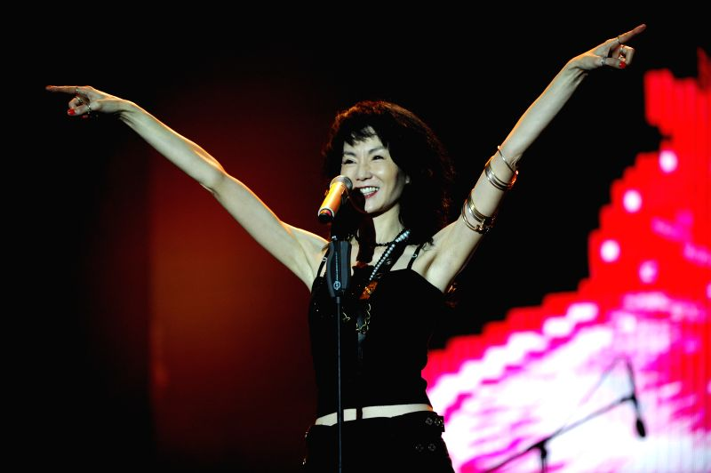 Hong Kong film star Maggie Cheung performs during the 2014 Strawberry Music Festival in Shanghai, east China, May 1, 2014. The festival runs here from May 1 to 3.  ..