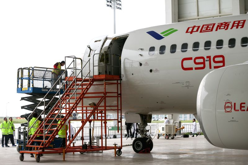 SHANGHAI, May 4, 2017 - Staff workers check a C919, China's first domestically-built large passenger jet, at a hangar of the Commercial Aircraft Corporation of China (COMAC) in Shanghai, east China, ...