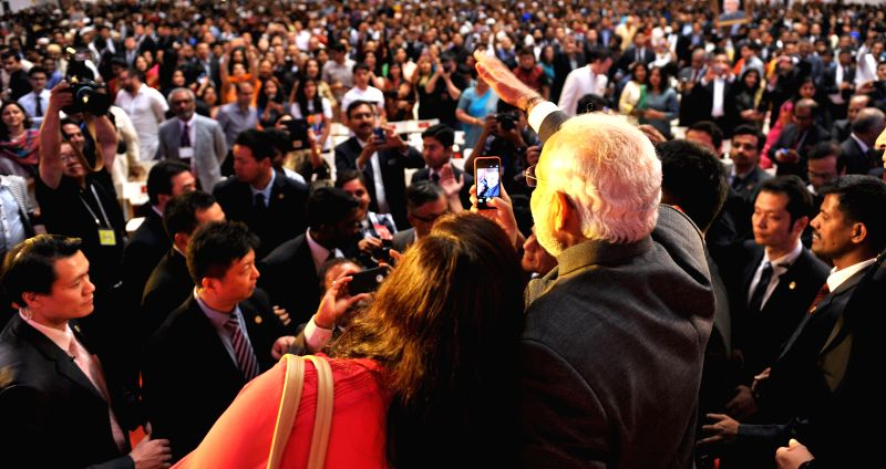 Prime Minister Narendra Modi interact with the people at the Indian Community Reception, in Shanghai, China on May 16, 2015. - Narendra Modi
