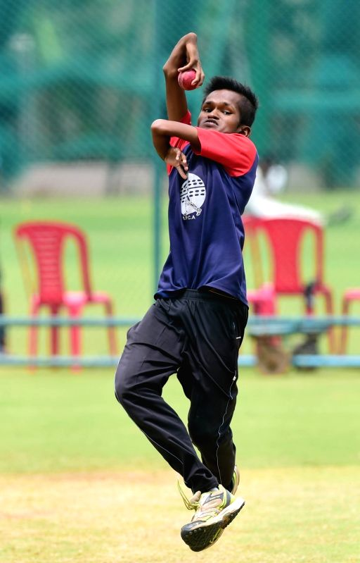 Shankar Sajjan, a differently-abled spinner bowls to Afghan players during a practice session in Bengaluru, on June 11, 2018.
