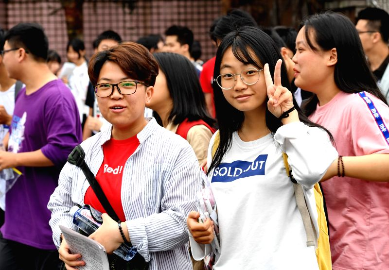 SHAOWU, June 7, 2018 - Examinees enter an exam venue at Shaowu No. 1 Middle School in Shaowu, southeast China's Fujian Province, June 7, 2018. About 9.75 million students have registered for the ...