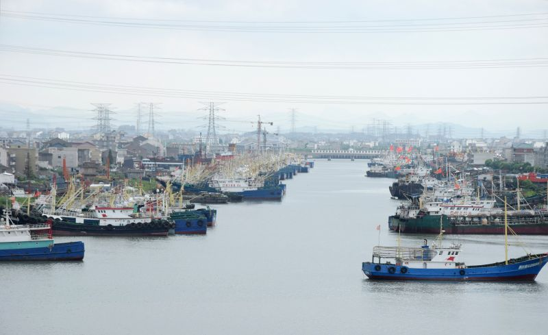 SHAOXING, Aug. 12, 2018 - Photo taken on Aug. 12, 2018 shows vessels anchoring at Jiaoshan dock for shelter in Wenling City, east China's Zhejiang Province. China's national observatory on Sunday ...