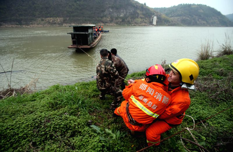 Rescuers work at the site where a boat sank in the Zijiang River of Shaoyang County, central China's Hunan Province, Feb. 22, 2015. Six people have died and three ...