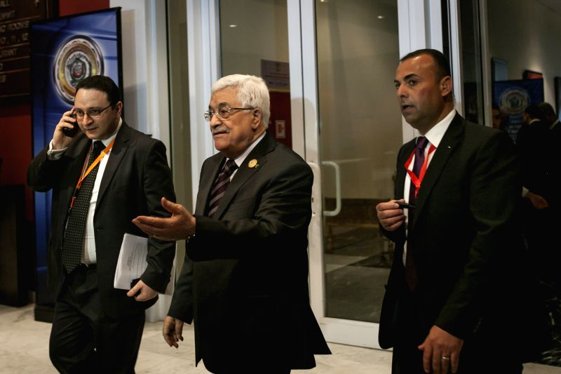SHARM EL-Palestinian President Mahmoud Abbas (C) walks out of the conference hall after a session of the Arab League Summit in Sharm El-Sheikh, Egypt, March 28, ...