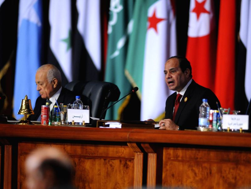 SHARM EL-The handout photo from Egypt's state-run news agency MENA shows Egyptian President Abdel-Fattah al-Sisi giving a speech at the Arab League Summit in Sharm ...