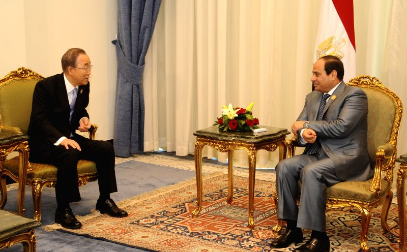 SHARM EL-The handout photo from Egypt's state-run news agency MENA shows Egyptian President Abdel Fattah al-Sisi (R) meets with United Nations Secretary General Ban ...