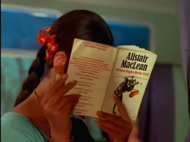 "Sharmila Tagore\'s character in ""Aradhana\"" with her copy of an Alistair MacLean novel as Rajesh Khanna serenades her with \""Mere Sapnon ki Rani...\"" - Rajesh Khanna"